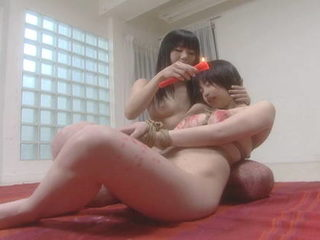 Mayura and Kasumi drip candle wax while bound
