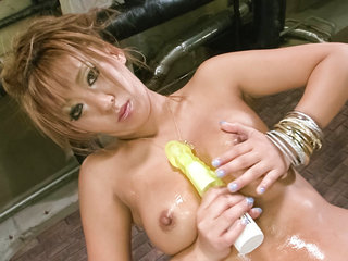 Asian av model Hina Maeda in gold lame strips and taunts..